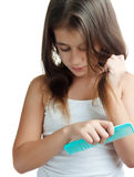 Hispanic girl combing her hair Stock Images