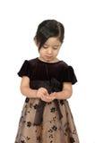 Hispanic girl counting money. Half body portrait of cute Hispanic girl in dress counting money in hands; isolated on white background Stock Photos