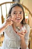Hispanic Girl Eats Ice Cream Stock Photography