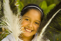 Hispanic girl and feathers stock photo