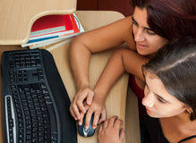 Hispanic girl and her mother using a computer Stock Photos
