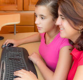 Hispanic girl and her mother working on a computer Royalty Free Stock Images