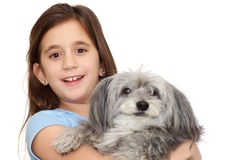 Hispanic girl hugging her dog isolated on w Stock Photos
