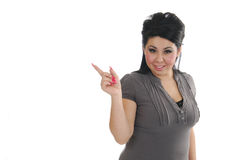 Hispanic Girl pointing at white space Royalty Free Stock Photography