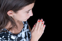 Hispanic girl praying with her eyes closed Royalty Free Stock Photos