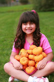 Hispanic girl with pumpkins Royalty Free Stock Image