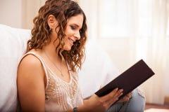 Hispanic girl reading a book Royalty Free Stock Image