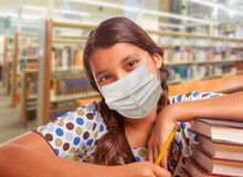 Free Hispanic Girl Student Wearing Face Mask Studying In Library Royalty Free Stock Photos - 189154888