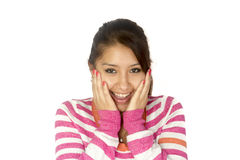 Hispanic girl surprised. Hispanic (Bolivian) girl with her hands on the face surprised and smiling. White background Royalty Free Stock Photos