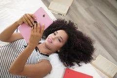 Hispanic Girl Using Digital Tablet For School Homework Royalty Free Stock Images