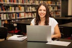 Hispanic girl using a laptop Royalty Free Stock Photography