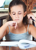 Hispanic girl  working on her homework Royalty Free Stock Image