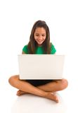 Hispanic girl working on laptop Stock Images