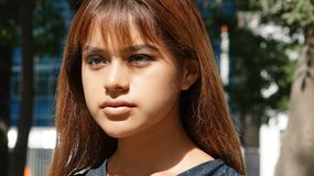 Hispanic Girl Youngster Staring Stock Image
