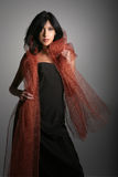 Hispanic Glamorous Woman With Copper Cape Royalty Free Stock Photo