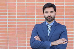 Hispanic good looking executive isolated with arms crossed Stock Photo