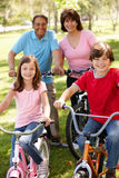 Hispanic grandparents with grandchildren on bikes Royalty Free Stock Photo
