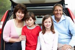 Hispanic grandparents and grandchildren outdoors. Smiling stock photo