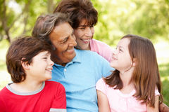 Hispanic grandparents and grandchildren outdoors. Smiling royalty free stock photography
