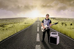 Hispanic guitarist plays guitar on the street Stock Images