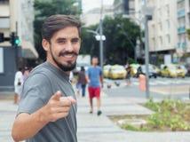 Hispanic guy with beard pointing at camera Royalty Free Stock Photography