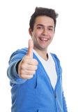 Hispanic guy in a blue hoody showing thumb up Royalty Free Stock Photos