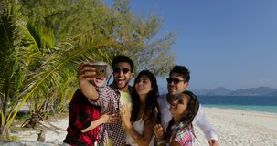 Hispanic Guy Calling People Group Take Selfie Photo On Cell Smart Phone On Beach Men And Women Tourists Communication