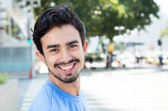 Hispanic guy in the city looking at camera Stock Images