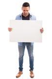 Hispanic guy holding a white sign Stock Images