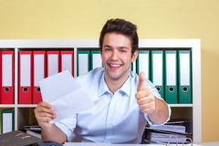 Hispanic guy at office is showing thumb up Royalty Free Stock Photography
