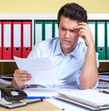 Hispanic guy with problems at office. Attractive hispanic guy at office has problems Stock Photos