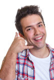 Hispanic guy says call me Stock Photo