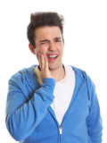 Hispanic guy with toothache Stock Images