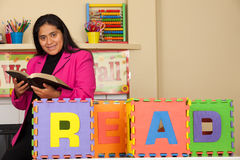 Hispanic Home Teacher Promoting Reading the Bible Royalty Free Stock Image