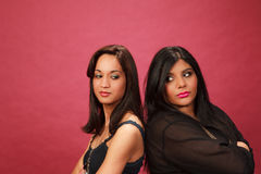Hispanic and Indian girl back to back angry Stock Images