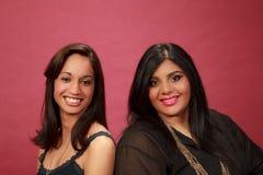 Hispanic and Indian girl smiling Stock Photo