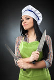 Hispanic lady chef with knives Royalty Free Stock Photos