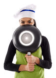 Hispanic lady cook with frying pan Stock Photography