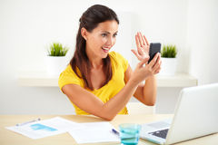 Hispanic lady taking a selfie with her cellphone Royalty Free Stock Photos
