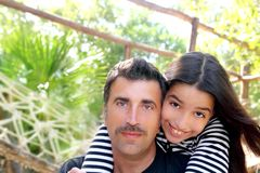 Hispanic latin father and teen daughter hug park Stock Photo