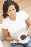 Hispanic Latina Woman Drinking Tea or Coffee Royalty Free Stock Images