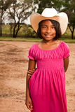Hispanic little girl wearing a hat with an American flag. Stock Images