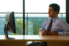 Hispanic Male Executive Office Looking Monitor Royalty Free Stock Photo