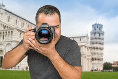 Hispanic Male Photographer With Camera at Leaning Tower of Pisa.  stock photo
