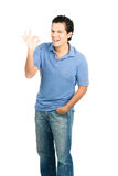 Hispanic Male Smiling OK Hand Signal Right Blue Royalty Free Stock Image