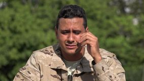 Hispanic male soldier crying