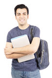 Hispanic male student smiling. Male student with a notebook isolated on withe background Royalty Free Stock Image