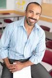 Hispanic Male Teacher. This image shows a Hispanic Male Teacher in his classroom Royalty Free Stock Photos