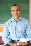 Hispanic Male Teacher. This image shows a Hispanic Male Teacher in his classroom Royalty Free Stock Image
