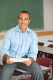 Hispanic Male Teacher. This image shows a Hispanic Male Teacher in his classroom Stock Images